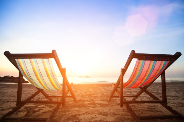 Beach chairs on the evening sea coast.